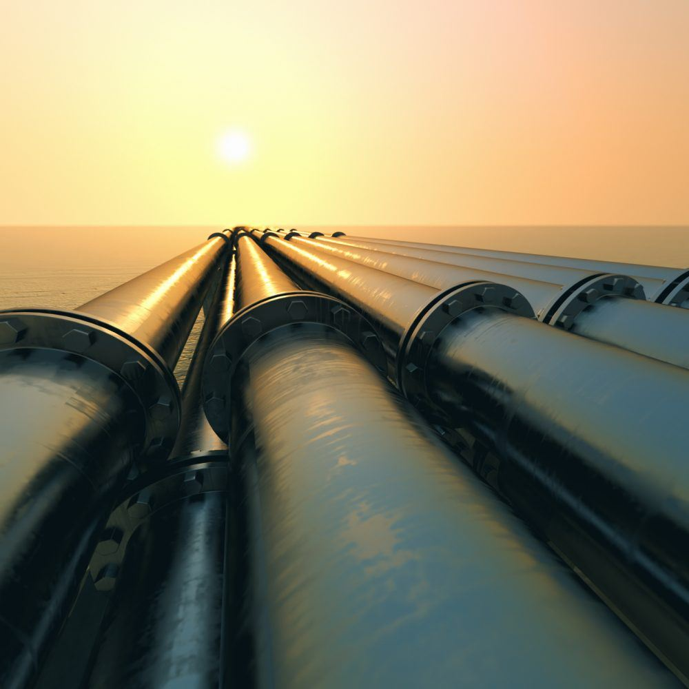 Pipelines into the horizon with sunset