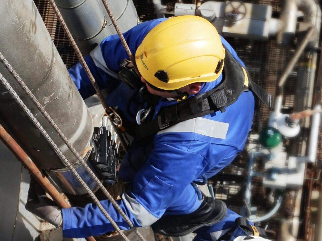 Technician performing rope access inspection
